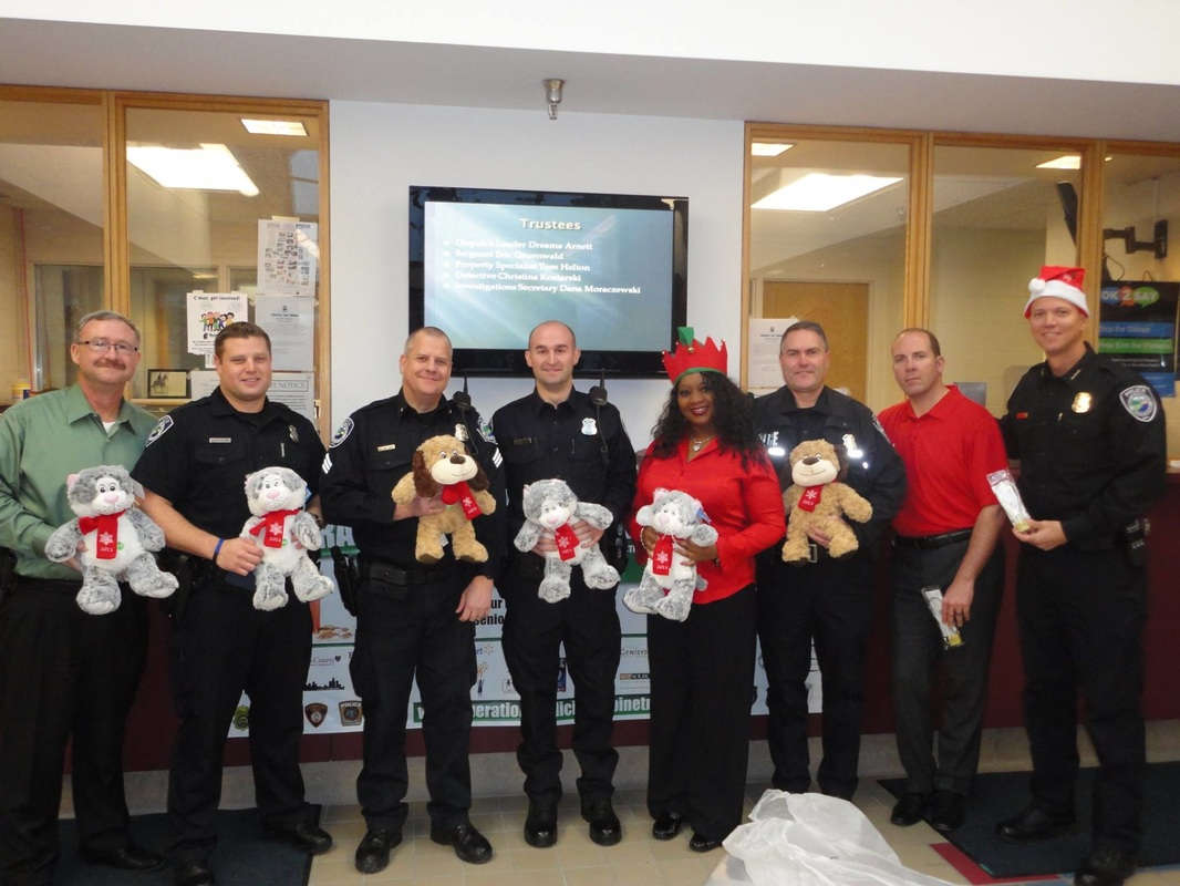 Police officers holding teddy bears with red hearts