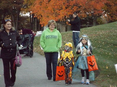 A family trick-or-treating in West Bloomfield