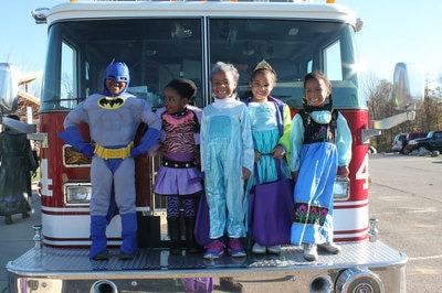 Kids dressed up in Halloween costumes during Trick-or-Treat Trail in West Bloomfield